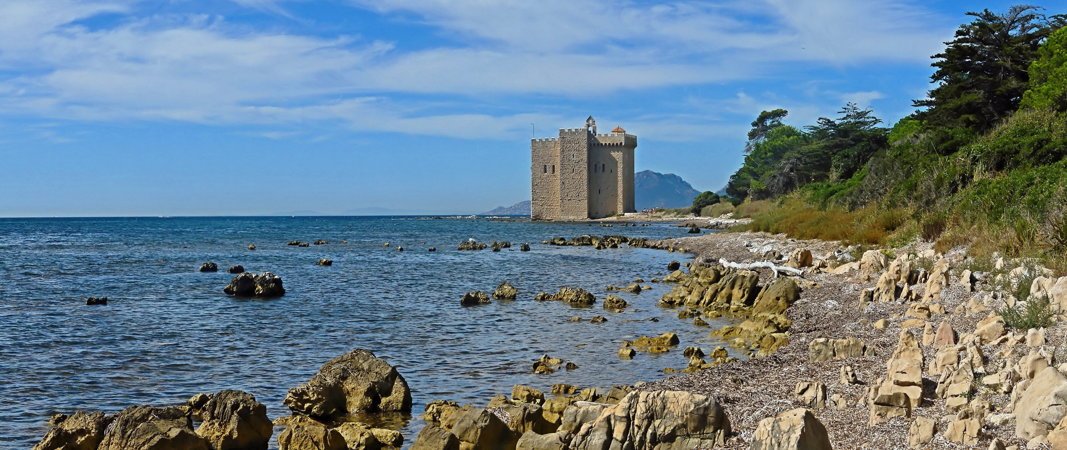 Old fortified monastery of the Lérins Abbey, on the island of Saint-Honorat, one of the Lérins Islands, next to Cannes.  Building started in 1073 to protect the monks from the attacks of Saracen pirates. The picture was obtained after stiching 3 pictures.